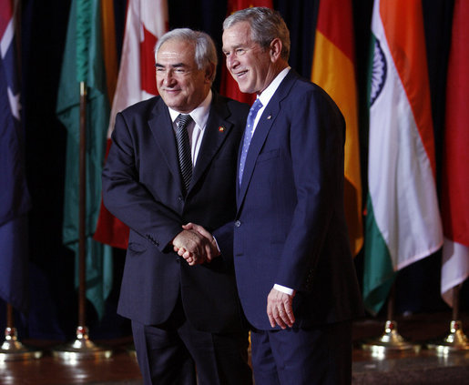 President George W. Bush welcomes Mr. Dominique Strauss-Kahn, Managing Director of the International Monetary Fund, to the Summit on Financial Markets and the World Economy Saturday, Nov. 15, 2008, at the National Building Museum in Washington, D.C. White House photo by Eric Draper