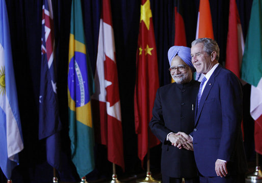 President George W. Bush welcomes Prime Minister Manmohan Singh of India, to the Summit on Financial Markets and the World Economy Saturday, Nov. 15, 2008, at the National Building Museum in Washington, D.C. White House photo by Eric Draper