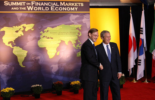 President George W. Bush welcomes World Bank President Robert B. Zoellick to the Summit on Financial Markets and the World Economy Saturday, Nov. 15, 2008, at the National Building Museum in Washington, D.C. White House photo by Chris Greenberg