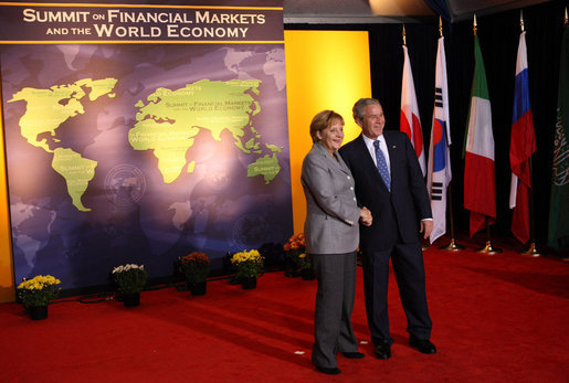 President George W. Bush welcomes Chancellor Angela Merkel of Germany to the Summit on Financial Markets and the World Economy Saturday, Nov. 15, 2008, at the National Building Museum in Washington, D.C. White House photo by Chris Greenberg