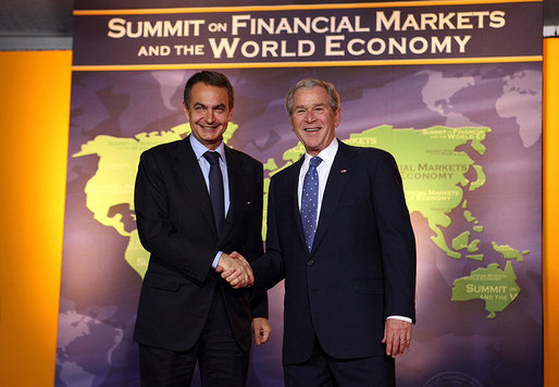President George W. Bush welcomes Spain's President Jose Luis Rodriguez Zapatero, a represntative of the European Union, to the Summit on Financial Markets and the World Economy Saturday, Nov. 15, 2008, at the National Building Museum in Washington, D.C. White House photo by Chris Greenberg