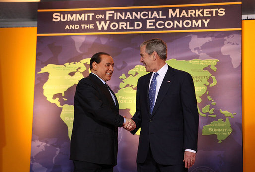 President George W. Bush welcomes Italy's Prime Minister Silvio Berlusconi to the Summit on Financial Markets and the World Economy Saturday, Nov. 15, 2008, at the National Building Museum in Washington, D.C. White House photo by Chris Greenberg