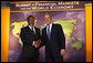 President George W. Bush welcomes South Africa President Kgalema Motlanthe to the Summit on Financial Markets and the World Economy Saturday, Nov. 15, 2008, at the National Building Museum in Washington, D.C. White House photo by Chris Greenberg