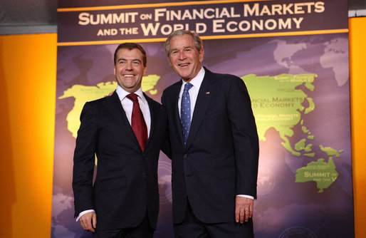 President George W. Bush welcomes Russian Federation President Dmitry Medvedev to the Summit on Financial Markets and the World Economy Saturday, Nov. 15, 2008, at the National Building Museum in Washington, D.C. White House photo by Chris Greenberg