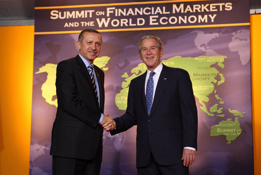 President George W. Bush welcomes Prime Minister Recep Tayyip Erdogan of Turkey to the Summit on Financial Markets and the World Economy Saturday, Nov. 15, 2008, at the National Building Museum in Washington, D.C. White House photo by Chris Greenberg