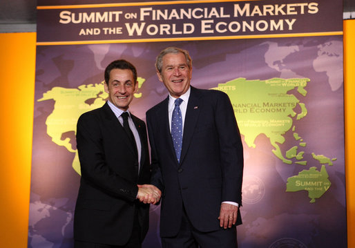 President George W. Bush welcomes French President Nicolas Sarkozy to the Summit on Financial Markets and the World Economy Saturday, Nov. 15, 2008, at the National Building Museum in Washington, D.C. White House photo by Chris Greenberg