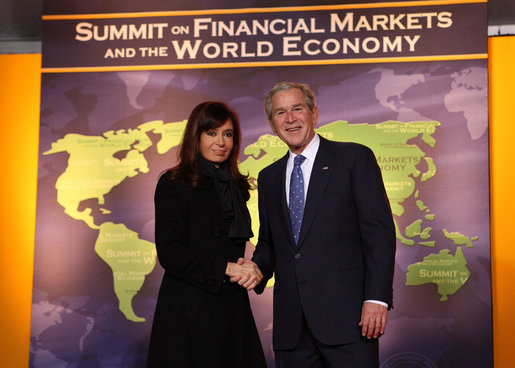 President George W. Bush welcomes Argentina President Cristina Fernandez de Kirchner to the Summit on Financial Markets and the World Economy Saturday, Nov. 15, 2008, at the National Building Museum in Washington, D.C. White House photo by Chris Greenberg
