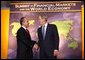 President George W. Bush welcomes Mexico's President Felipe Calderon to the Summit on Financial Markets and the World Economy Saturday, Nov. 15, 2008, at the National Building Museum in Washington, D.C. White House photo by Chris Greenberg
