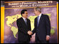 President George W. Bush welcomes the People's Republic of China President Hu Jintao to the Summit on Financial Markets and the World Economy Saturday, Nov. 15, 2008, at the National Building Museum in Washington, D.C. White House photo by Chris Greenberg