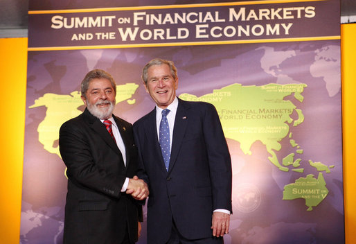 President George W. Bush welcomes the Brazil's President Luiz Inacio Lula da Silva to the Summit on Financial Markets and the World Economy Saturday, Nov. 15, 2008, at the National Building Museum in Washington, D.C. White House photo by Chris Greenberg