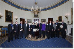 President George W. Bush and Mrs. Laura Bush stand with the recipients of the 2008 National Medal of Arts and Presidential Citizen Medal recipients in the Blue Room at the White House Monday, Nov., 17, 2006. Pictured from left, Henry 'Hank' Jones, Jr., jazz musician; Wayne Reynolds, president of the board of the Ford's Theatre Society; Stan Lee, legendary comic book creator; Paul Tetreault, director of the Ford's Theatre Society; Olivia de Havilland, actress; Carla Maxwell, artistic director of Jose Limon Dance Foundation; Hazel O'Leary, president of Fisk University and Paul Kwami, musical director for Fisk University Jubilee Singers; Dana Gioia, chairman of the National Endowment for the Arts; Adair Wakefield Margo, chairman for the President's Committee on Arts and Humanities; Jesus Moroles, sculptor; and Robert Capanna, of the Presser Foundation.  White House photo by Chris Greenberg
