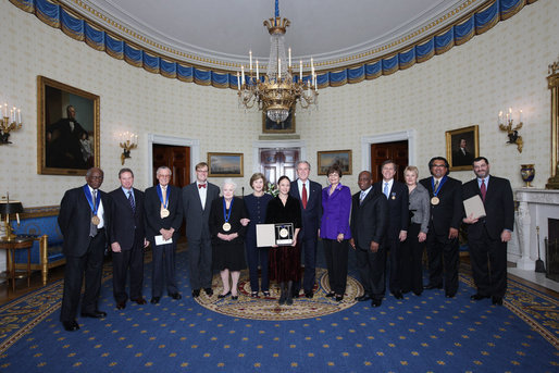 President George W. Bush and Mrs. Laura Bush stand with the recipients of the 2008 National Medal of Arts and Presidential Citizen Medal recipients in the Blue Room at the White House Monday, Nov., 17, 2008. Pictured from left, Henry 'Hank' Jones, Jr., jazz musician; Wayne Reynolds, president of the board of the Ford's Theatre Society; Stan Lee, legendary comic book creator; Paul Tetreault, director of the Ford's Theatre Society; Olivia de Havilland, actress; Carla Maxwell, artistic director of Jose Limon Dance Foundation; Hazel O'Leary, president of Fisk University and Paul Kwami, musical director for Fisk University Jubilee Singers; Dana Gioia, chairman of the National Endowment for the Arts; Adair Wakefield Margo, chairman for the President's Committee on Arts and Humanities; Jesus Moroles, sculptor; and Robert Capanna, of the Presser Foundation. White House photo by Chris Greenberg
