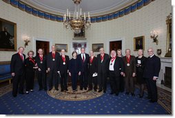 President George W. Bush and Mrs. Laura Bush stand with the recipients of the 2008 National Humanities Medal in the Blue Room at the White House Monday, Nov., 17, 2006. Pictured from left, Thomas A. Saunders III, president, and Jordan Horner Saunders, Board of Directors, North Shore Long Island Jewish Health Systems; Albert Marrin, author; Richard Brookhiser, Senior Editor, National Review; Harold Holzer, Senior Vice President for External Affairs, Metropolitan Museum of Art; Gabor S. Boritt, Director, Civil War Institute, Gettysburg College; Milton J. Rosenberg, WGN Radio Chicago; Myron Magnet, editor, City Journal; Adair Wakefield Margo, Presidential Citizen Medal recipient; Robert H. Smith, president, Vornado/Charles E. Smith; Laurie Norton, Director and CEO, Norman Rockwell Museum; Bruce Cole, Presidential Citizen Medal recipient. White House photo by Chris Greenberg