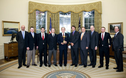 President George W. Bush stands with members of the U.S. Ryder Cup Team Monday, Nov. 17, 2008, in the Oval Office of the White House. The Ryder Cup is awarded biennially in a golf championship between the United States and Europe. The U.S. won the 2008 Cup by five points in September, the largest margin of victory since 1981. White House photo by Chris Greenberg