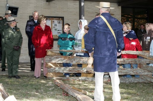 Mrs. Laura Bush watches with children as a reenactor demonstrates rail splitting during her visit to the Abraham Lincoln Birthplace National Historical Site Tuesday, Nov. 18, 2008, in Hodgenville, KY. White House photo by Joyce N. Boghosian