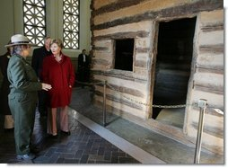 Mrs. Laura Bush tours a replica Log Cabin of Abraham Lincoln's Birthplace during her visit to the Abraham Lincoln Birthplace National Historic Site Tuesday, Nov. 18, 2008, in Hodgenville, KY. Mrs. Bush is led on the tour by Ms. Sandy Brue, Chief of Interpretation and Resource Management, Abraham Lincoln Birthplace National Historic Site.  White House photo by Joyce N. Boghosian
