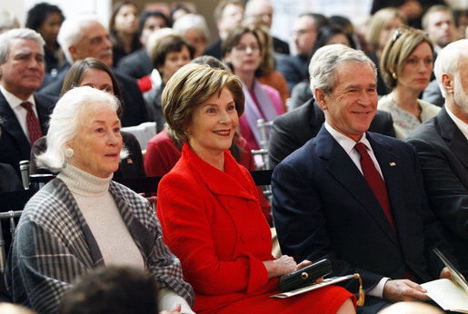 President George W. Bush and Mrs. Laura Bush smile as they participate Wednesday, Nov. 19, 2008, in the reopening of the National Museum of American History in Washington, D.C. White House photo by Eric Draper