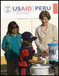 Mrs. Laura Bush and Ms. Nancy Quispitupa, Program Manager and Community Trainer, watch as 8-year-old William Sebastian Hernandez Jeri demonstrates learned hand-washing techniques Friday, Nov. 21, 2008, at the San Clemente Health Center in San Clemente, Peru. The center is the town's major health provider and serves an average of 80 patients per day. White House photo by Joyce N. Boghosian