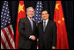 President George W. Bush participates in a greeting with Hu Jintao, President of the People's Republic of China, prior to the start of their meeting Friday, Nov. 21, 2008 in Lima, Peru. President Bush is in Lima to attend the APEC Peru 2008 summit. White House photo by Chris Greenberg