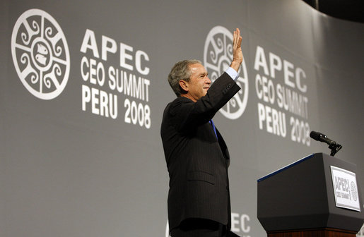"President George W. Bush waves to the audience after delivering his address to the APEC CEO Summit 2008 in Lima, Peru. Said the President in wrapping up his remarks, ""Thanks for letting me come by. Que Dios le bendiga. God bless."" White House photo by Eric Draper"