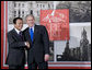 President George W. Bush and Prime Minister Taro Aso of Japan pause for photographs prior to their meeting Saturday, Nov. 22, 2008, in Lima, Peru. White House photo by Eric Draper