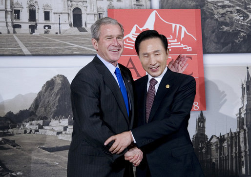 President George W. Bush and President Lee Myung-bak of the Republic of Korea pause for photographers Saturday, Nov. 22, 2008, prior to their meeting in Lima, Peru, site of the 2008 APEC Summit. White House photo by Eric Draper