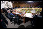 President George W. Bush relaxes in his chair during the afternoon leaders retreat Saturday, Nov. 22, 2008, at the APEC Summit in Lima, Peru. White House photo by Eric Draper