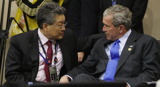 President George W. Bush talks with Spencer Kim, Chairman of CBOL Corporation and U.S. representative to the APEC Business Advisory Council, during a dialogue with ABAC leaders Saturday, Nov. 22, 2008, in Lima, Peru. White House photo by Eric Draper