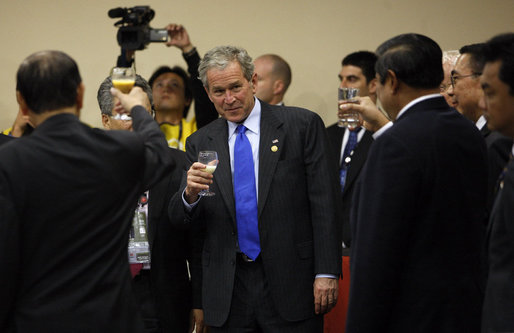 President George W. Bush lifts his glass during a toast given Saturday, Nov. 22, 2008, by Peru's President Alan Garcia during the Leaders Dialogue with APEC Business Advisory Council at the Ministry of Defense Convention Center in Lima, Peru. White House photo by Eric Draper