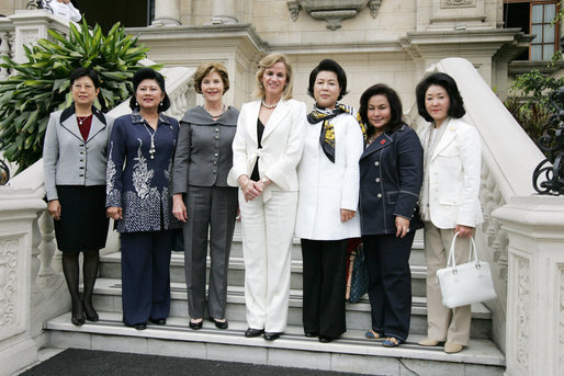 Mrs. Laura Bush stands for photographs on the steps of the Government Palace Residence Saturday, Nov. 22, 2008, with spouses of APEC leaders following a breakfast hosted by Mrs. Pilar Nores de Garcia, First Lady of Peru, in Lima. With her, from left are: Madam Ho, Spouse of Prime Minister Lee Hsien Loong of Singapore; Mrs. Kristiani Herawati, spouse of Indonesia's President Susilo Bambang Yudhoyono; Mrs. Bush; Mrs. Pilar Nores Bodereau de Garcia, spouse of Peru's President Alan Garcia; Mrs. Kim Yoon-ok, spouse of President Lee Myung-bak; Mrs. Rosmah Mansor, spouse of Malaysian Deputy Prime Minister Najib Razak, and Mrs. Chikako Aso, wife of Prime Minister Taro Aso of Japan. White House photo by Joyce N. Boghosian