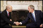 President George W. Bush and Prime Minister Ehud Olmert shake hands during the Israeli leader's visit Monday, Nov. 24, 2008, to the Oval Office. White House photo by Eric Draper