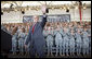 "President George W. Bush waves to the troops at Fort Campbell, Ky., Tuesday, Nov. 25, 2008, after being introduced on stage during a Thanksgiving visit. Said the President, ""Over the past seven years, folks from this base have done exactly what they were trained to do."" ""You have taken the battle of the terrorists overseas so we do not have to face them here in the United States. You have helped counter the hateful ideology of tyranny and terror with a more hopeful vision of justice and liberty. You're part of the great ideological struggle of our time. With the soldiers of Fort Campbell out front, the forces of freedom and liberty will prevail."" White House photo by Eric Draper"