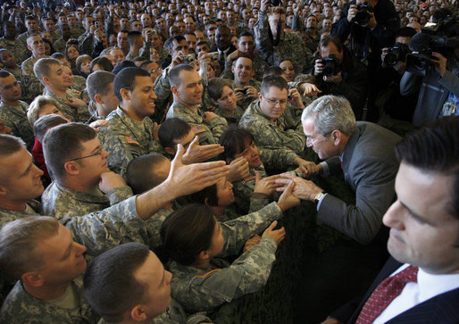 "President George W. Bush greets his audience Tuesday, Nov. 25, 2008, after addressing the troops at Fort Campbell, Ky. Said the President, ""I'm honored to be with the Screaming Eagles of the 101st Airborne; the Night Stalkers of the 160th; the Green Berets of the 5th Special Forces Group, all members of the Fort Campbell community. You are part of the finest military in the world. I have one word for you: Hooah!"" White House photo by Eric Draper"