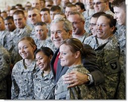 President George W. Bush stands with troops on stage Tuesday, Nov. 25, 2008, at Fort Campbell, Ky., one of the Army's premier training and deployment installations and home of the Screaming Eagles of the 101st Airborne. White House photo by Eric Draper