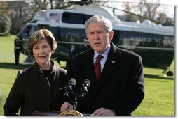 President George W. Bush and Laura Bush extend their condolences to those suffering from the terrorist attacks in Mumbai, India, upon their arrival to the White House Saturday, Nov. 29, 2008, in Washington DC. White House photo by Joyce N. Boghosian