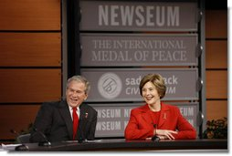 President George W. Bush and Mrs. Laura Bush react during a question and answer session Monday, Dec. 1, 2008, at the Saddleback Civil Forum on Global Health at the Newseum in Washington, D.C. White House photo by Eric Draper