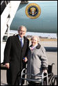 President George W. Bush poses with Donna Turner, a USA Freedom Corps Service recognition recipient honored by President Bush for her volunteer service, Tuesday, Dec. 2, 2008, on arrival at the Piedmont Triad International Airport in Greensboro, N.C. White House photo by Chris Greenberg