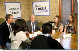 President George W. Bush participates in a roundtable on mentoring children of prisoners initiative Tuesday, Dec. 2, 2008, at the Youth Focus, Inc., in Greensboro, N.C., where President Bush praised the Youth Focus program for their work in helping youngsters toward a brighter future. White House photo by Chris Greenberg