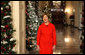 "Mrs. Laura Bush stands in the East Room of the White House Wednesday, Dec. 3, 2008, as she reveals the 2008 White House holiday theme, ""A Red, White and Blue Christmas"" to approximately 120 members of the media during the White House Holiday Press Preview. White House photo by Chris Greenberg"
