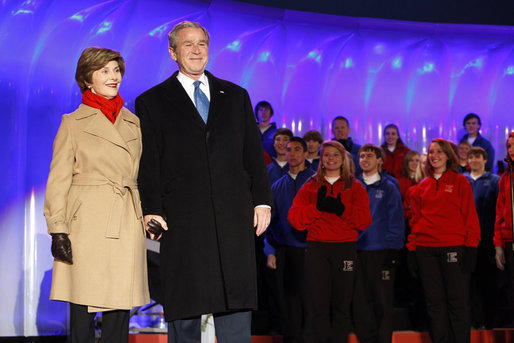 President George W. Bush and Mrs. Laura Bush join the Enterprise High School Encores from Enterprise, Ala., on stage at the Ellipse Thursday, Dec. 4, 2008, during the Lighting of the National Christmas Tree in Washington, D.C. White House photo by Eric Draper
