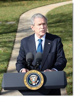 "President George W. Bush delivers his remarks on the economy from the south driveway Friday, Dec. 5, 2008, at the White House. President Bush stated during his remarks, ""We're working with the Federal Reserve and FDIC, and credit is beginning to move. A market that was frozen is thawing. There's still more work to do. But there are some encouraging signs.""  White House photo by Chris Greenberg"
