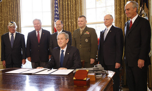 "President George W. Bush smiles after signing the Presidential proclamation designating the World War II Valor in the Pacific National Monument and the Presidential proclamation in honor of National Pearl Harbor Remembrance Day 2008 in the Oval Office of the White House. With him for the signing Friday, Dec. 5, 2008, are from left: Pearl Harbor Survivor Jay Groff; George Sullivan, Chairman, Arizona Memorial Museum Association; Secretary Donald Winter, U.S. Department of the Navy; Gen. James ""Hoss"" Cartwright, Vice Chairman, Joint Chiefs of Staff; Secretary James Peake, U.S. Department of Veterans Affairs, and Secretary Dirk Kempthorne, U.S. Department of the Interior. White House photo by Eric Draper"