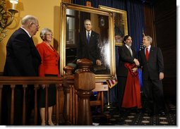 President George W. Bush shakes hands with artist Mark Carder Saturday, Dec. 6, 2008, at the unveiling of the Union League of Philadelphia's Portrait of a President. Looking on at left are Bruce and Eileen Hooper, Commissioners of the portrait, which will join 26 others of American Presidents in the Union League's Presidential Portrait Collection.  White House photo by Eric Draper