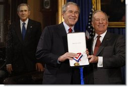 "President George W. Bush receives the Union League of Philadelphia's Gold Medal Award from League President Fred Haab Saturday, Dec. 6, 2008, during ceremonies at its Philadelphia headquarters. Said the President, ""One can learn a lot from the past, and The Union League is doing its part to tell the true story of our great nation. In short, I thank you for your service to your community and our country.""  White House photo by Eric Draper"