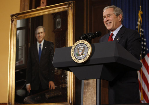 President George W. Bush stands next to his portrait as he delivers remarks Saturday, Dec. 6, 2008, to the Union League of Philadelphia. Founded in 1862, the Union League has hosted U.S. Presidents, heads of state, industrialists, entertainers and visiting dignitaries from around the globe. The portrait, painted by Mark Carder and presented by the League, will become part of its Presidential Portrait Collection. White House photo by Eric Draper