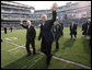 President George W. Bush walks onto the playing turf at Philadelphia's Lincoln Financial Field with U.S. Secretary of Defense Robert Gates Saturday, Dec. 6, 2008, for the 2008 Army-Navy game. The rivalry, a tradition since 1908, was won by the Midshipmen, who delivered a 28-0 shutout to the Black Knights. White House photo by Eric Draper