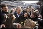 President George W. Bush is swarmed by the Army cheerleading squad Saturday, Dec. 8, 2008, on the field at Lincoln Financial Field in Philadelphia, for the 2008 Army-Navy game. White House photo by Eric Draper