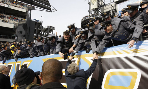 President George W. Bush reaches up to the Cadets of West Point Saturday, Dec. 6, 2008, at Lincoln Financial Field where he joined the global millions in watching the 2008 Army-Navy game. The rivalry, pitting West Point and the Naval Academy, has been a tradition since 1908. The 28-0 win by the Midshipman gave them 53 wins to Army's 49. White House photo by Eric Draper
