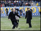 President George W. Bush playfully kicks a 15-yarder from around the 30 yard line Saturday, Dec. 6, 2008, as he took the field at Philadelphia's Lincoln Financial Field for the 2008 Army-Navy game. The Commander in Chief was headed to midfield for the coin toss, when he spotted the ball on the tee and went for it.  White House photo by Eric Draper