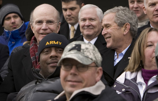 President George W. Bush sits among U.S. Army troops wounded while serving in Iraq and Afghanistan as they cheer for the Black Knights of West Point during the first half of the 2008 Army Navy game at Lincoln Financial Field in Philadelphia. White House photo by Eric Draper